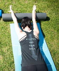 Pilates enthusiast wearing Pilates Nerd Down Under Pilates has your back tank