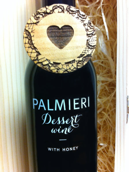 Dessert wine with wooden heart brooch