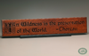 """In Wildness is the preservation of the World."" from Henry David Thoreau is a beautifully carved Wisdom In Wood® inspirational wall art quote (Classic Oak finish)"