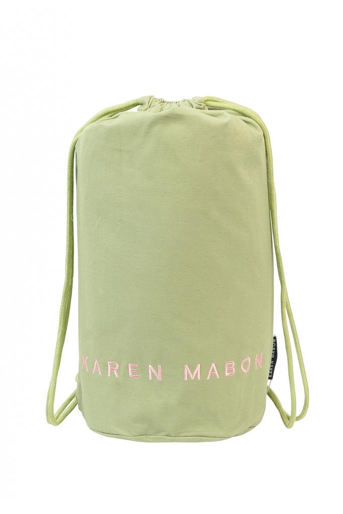 Pistachio green duffel bag with embroidered Karen Mabon logo in pink