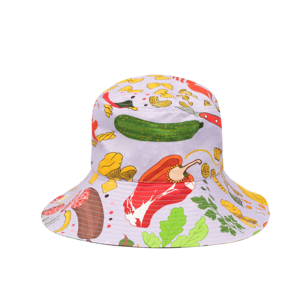 Product photo of Sun Hat on white background, the lilac sun hat is decorated with food illustrations such as vegetables, meat and pasta shells
