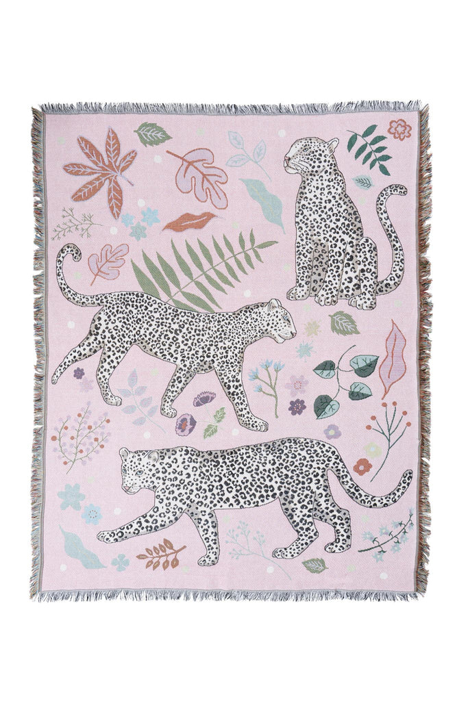 Snow Leopard Blanket by Karen Mabon with three snow leopards pink blankets surrounded by leaves.