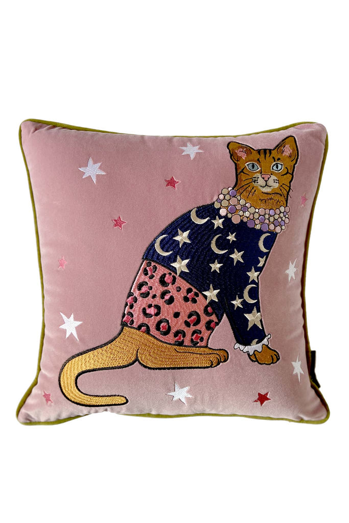 Karen Mabon pink velvet embroidered cushion with fashion cat, wearing a navy jumper and beads