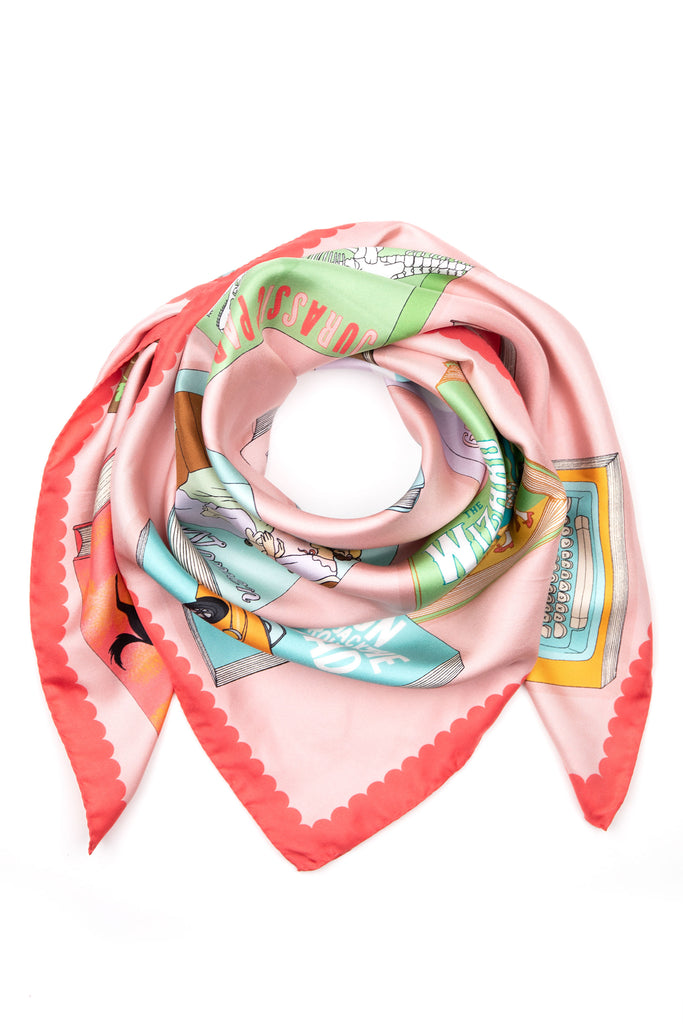 Karen Mabon Silk Scarf in pink, printed with favourite novels and famous book covers, such as The Bell Jar, Pride & Prejudice, Watership Down, Life of Pi, Black Beauty, Moby Dick, Great Gatsby, Ballet Shoes, 1984, The Secret Garden, Dracula, Jurassic Park, Little Women, Wizard of Oz, On the Road, Dracula, The Shining.