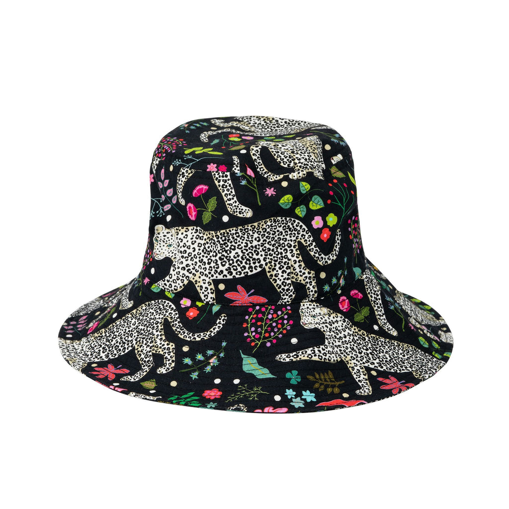 Product photo on a white background of sun hat, featuring snow leopards, leaves and flower illustrations on dark background.