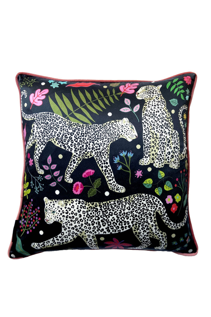 Karen Mabon silk cushion, with navy backdrop, featuring three snow leopards, leaves and flowers. Pink edges.