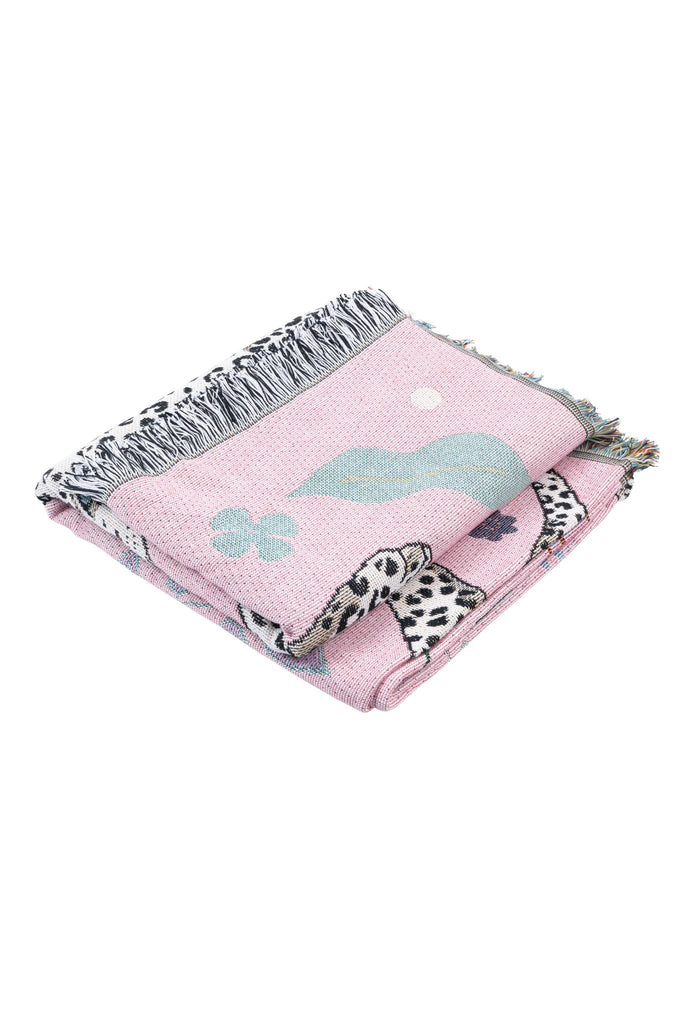 Product photo on white background of pink snow leopard blanket folded in a square