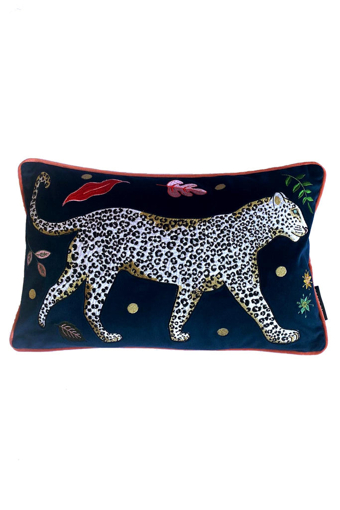 Leopard Bolster Cushion, navy blue velvet with white snow leopard embroidery surrounded by leaf motifs, edged with pink contrast velvet trim