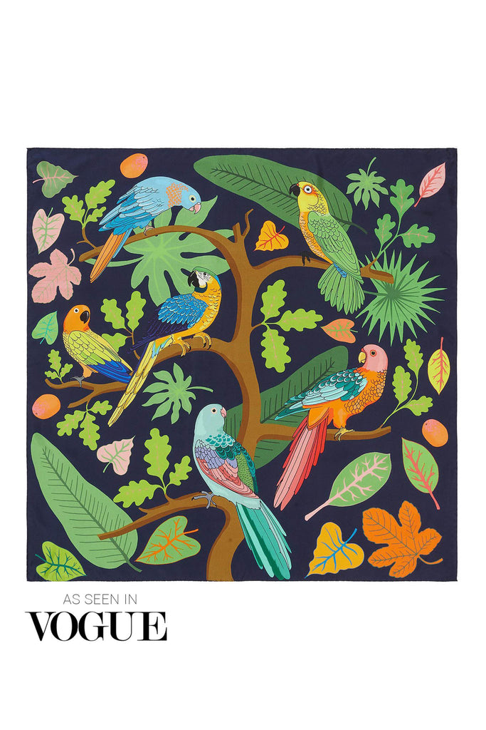 Playful silk scarf featuring parrots in a bright jungle scene with a navy background