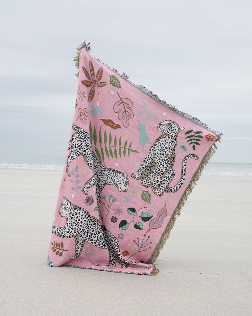 Snow Leopard Blanket on the beach