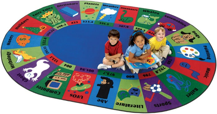 "Dewey Decimal Fun Library Circle Time Rug, 6'9"" x 9'5"" Oval"