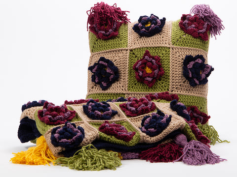Happy Garden Throw & Cushion Set by Zoë Potrac in Deramores Studio DK
