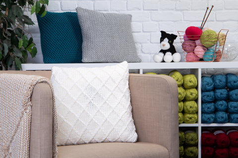 Three Cosy Cushions by Sarah Murray in Deramores Studio Chunky