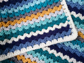 Ric Rac Blanket by Leonie Morgan in Deramores Studio DK