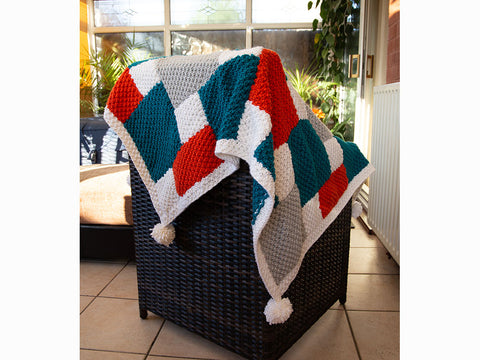 Bright Geometric Blanket by Sarah Murray in Deramores Studio Chunky