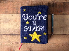 You're a Star Notebook Cover Knitting Kit and Pattern in Deramores Yarn