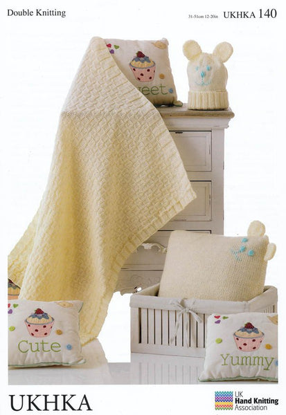 Blanket, Cushion and Hat in DK (UKHKA140)-Deramores