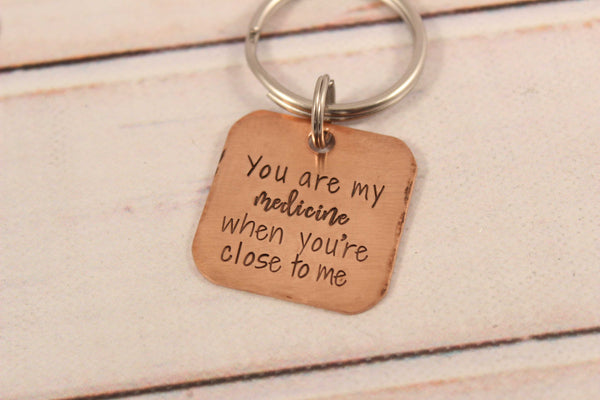 """You are my medicine when you're close to me"" copper keychain - Completely Hammered"