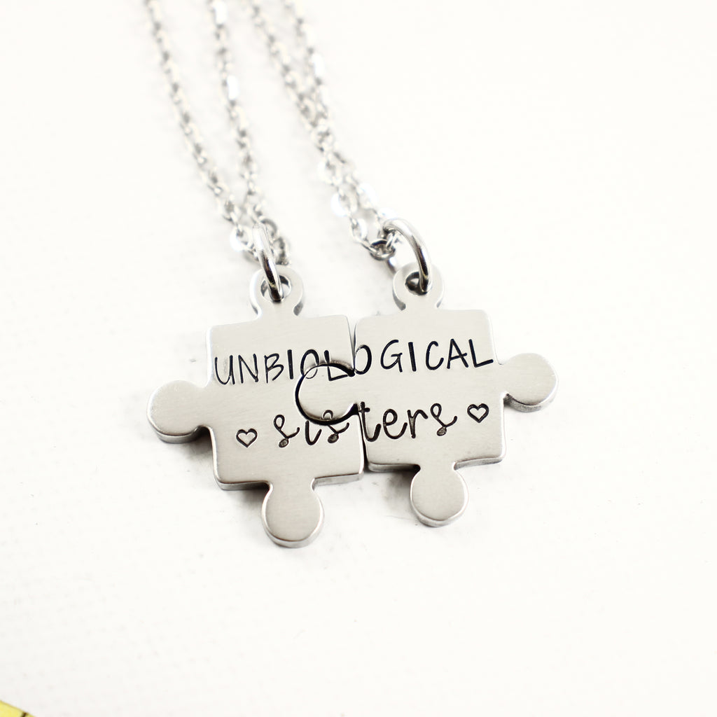 """Unbiological Sisters"" - Stainless Steel Puzzle Piece Couples Set - Keychains - Completely Hammered - Completely Wired"