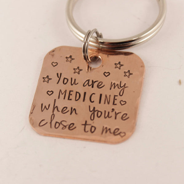 """You are my medicine when you're close to me"" copper keychain - Keychains - Completely Hammered - Completely Wired"