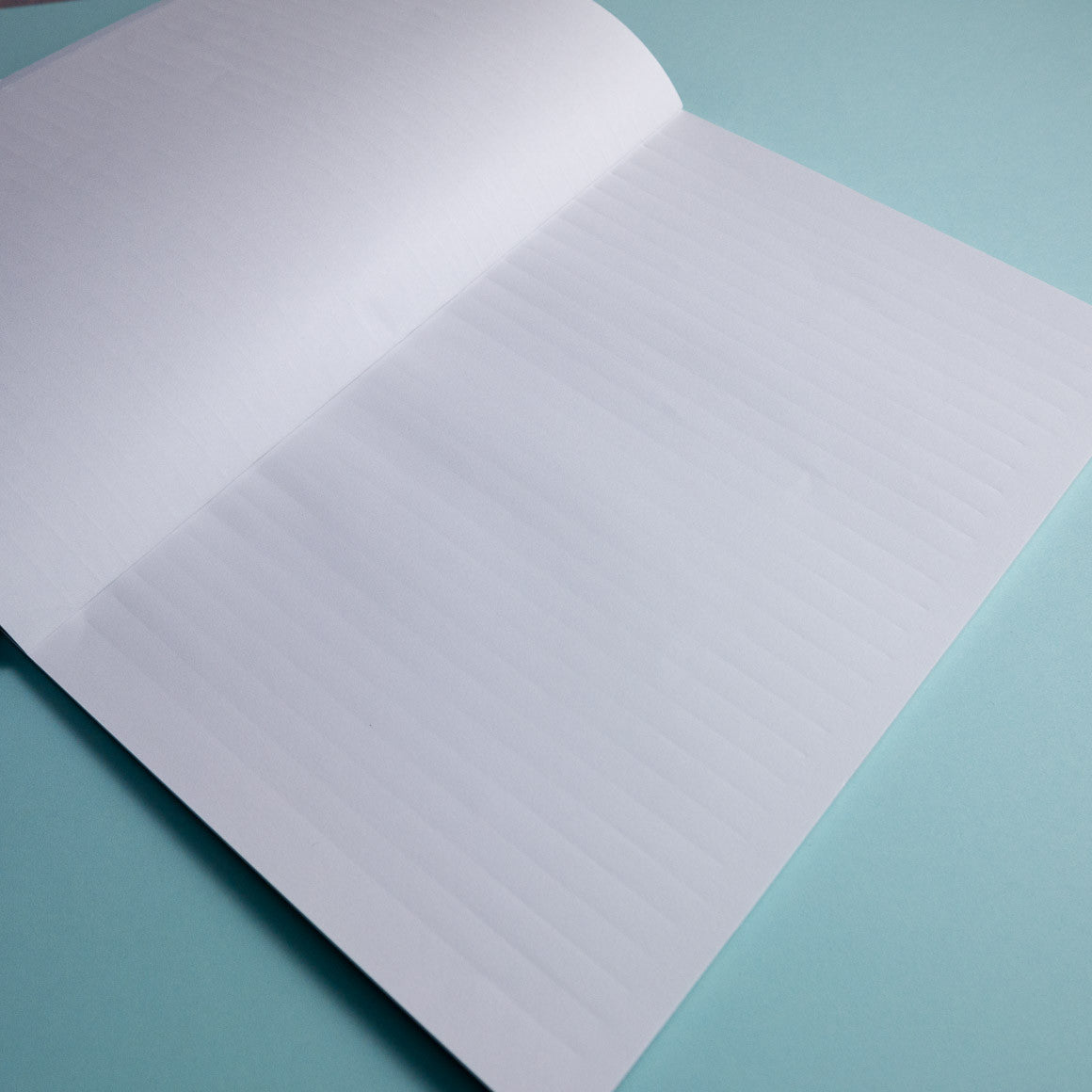 crimped paper lined notebook