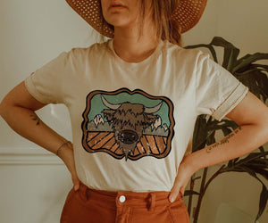 """Ole Highland on the Mountain"" Cartoon Highland Cow IVORY Graphic Tee ~ (made 2 order)"