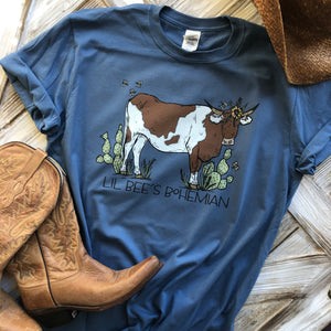 """Ole Cattle Call"" Brown & White Spotted Cow Denim Blue Graphic Tee"