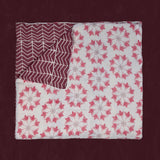 Adelina Quilt by Allem Studio - Round floral pattern of pink and merlot colour on one side. The reverse print has a geometric pattern in a contrast merlot colour.