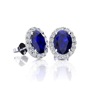 Oval shape sapphire and halo diamond stud earrings in 14k white gold