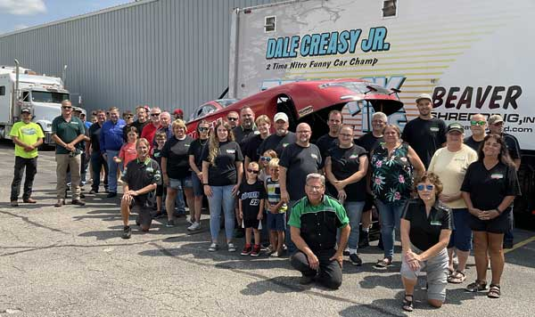 Group photo in front of Dale Creasy's car