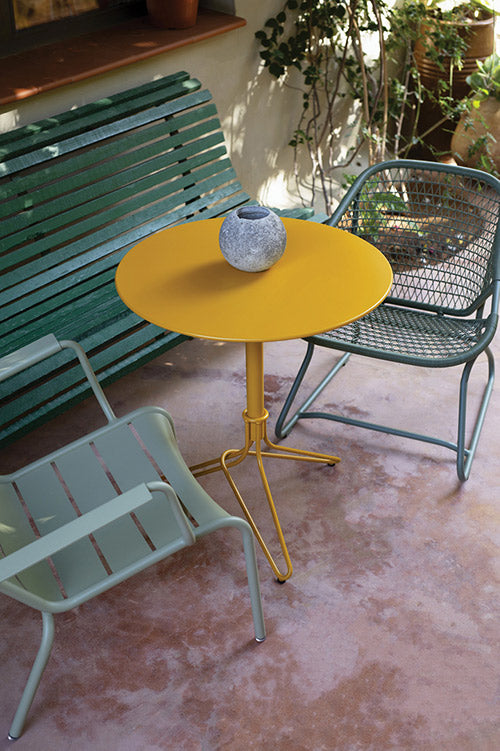 Fermob Flower Pedestal Table in patio setting