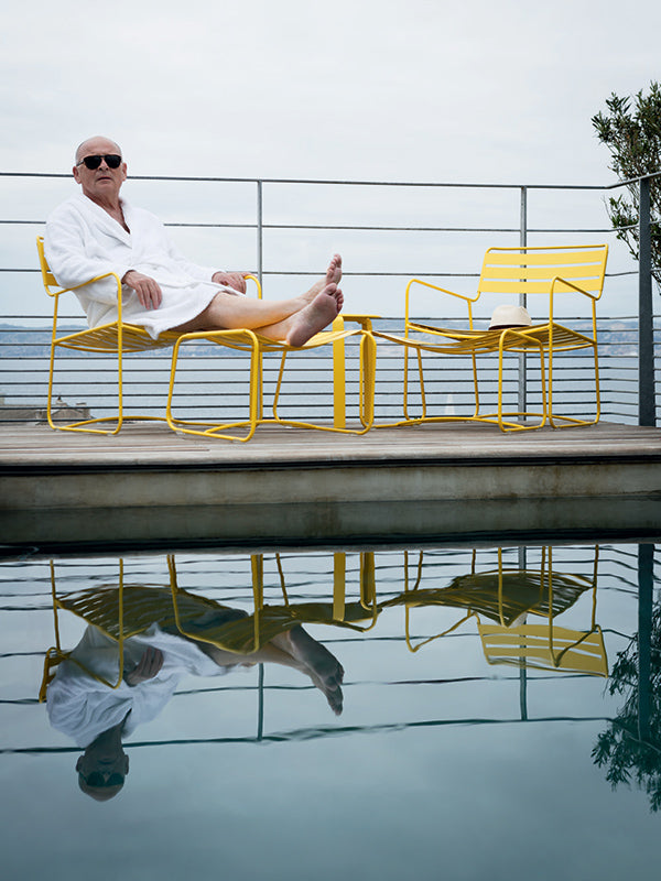 yellow fermob chairs by pool