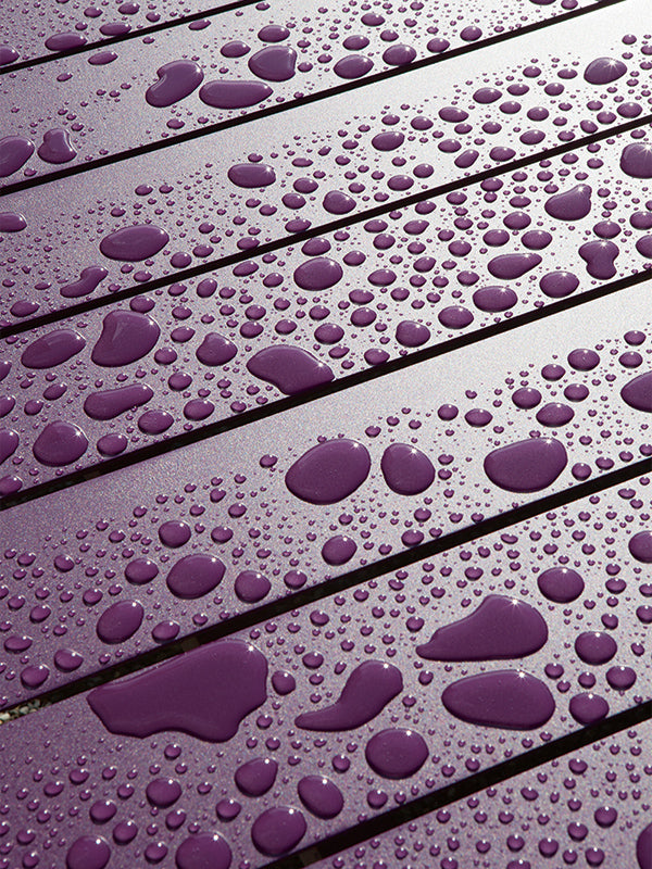 water-droplets-on-purple-wood
