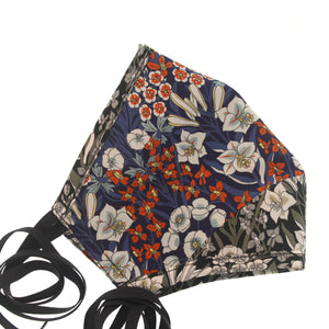 A Liberty Print Face Mask in Blue, Orange, + Grey Floral Silk