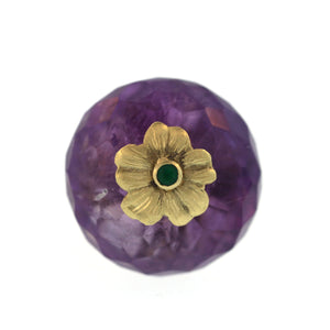 An Amethyst + Emerald Flower Ring