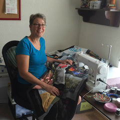 Julie - Moss-quilting - at - sewing - machine