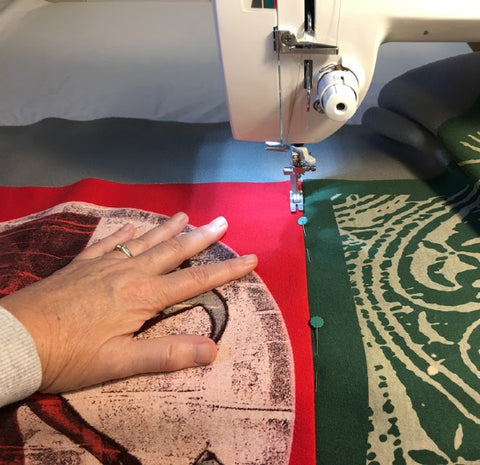 Julie Moss - Hands - at - sewing - machine - Replay Quilts