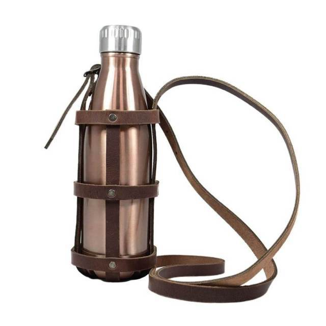 leather water bottle holder holding rose gold stainless steel water bottle