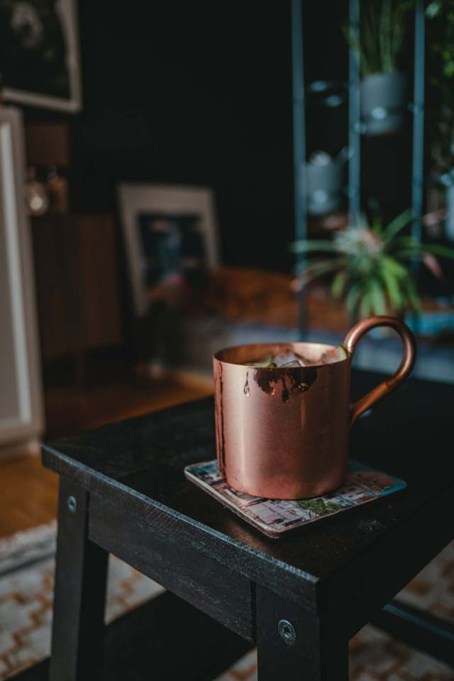 copper mug placed on a back steel chair stool