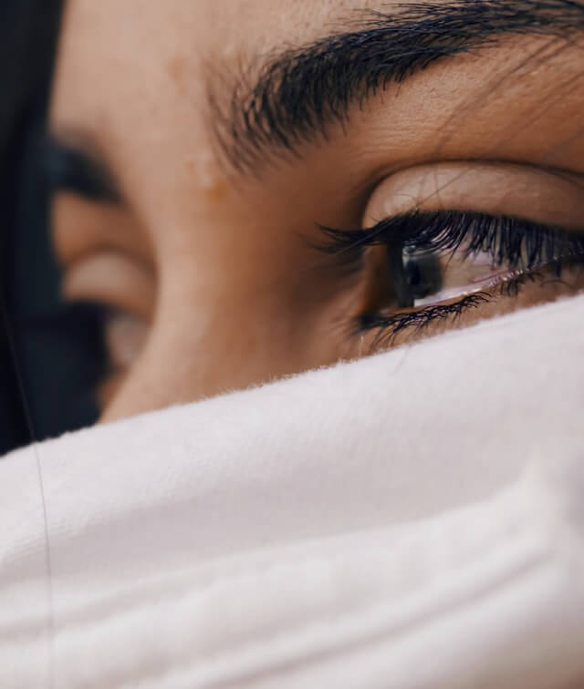 focus close up on woman eyes filled with tears