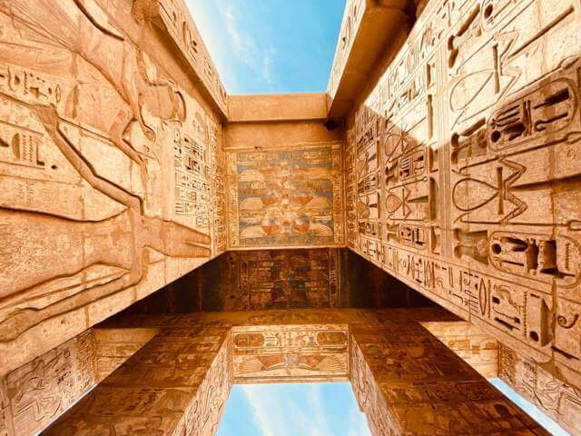 low angle towards the sky of egyptian ancient hieroglyphics building