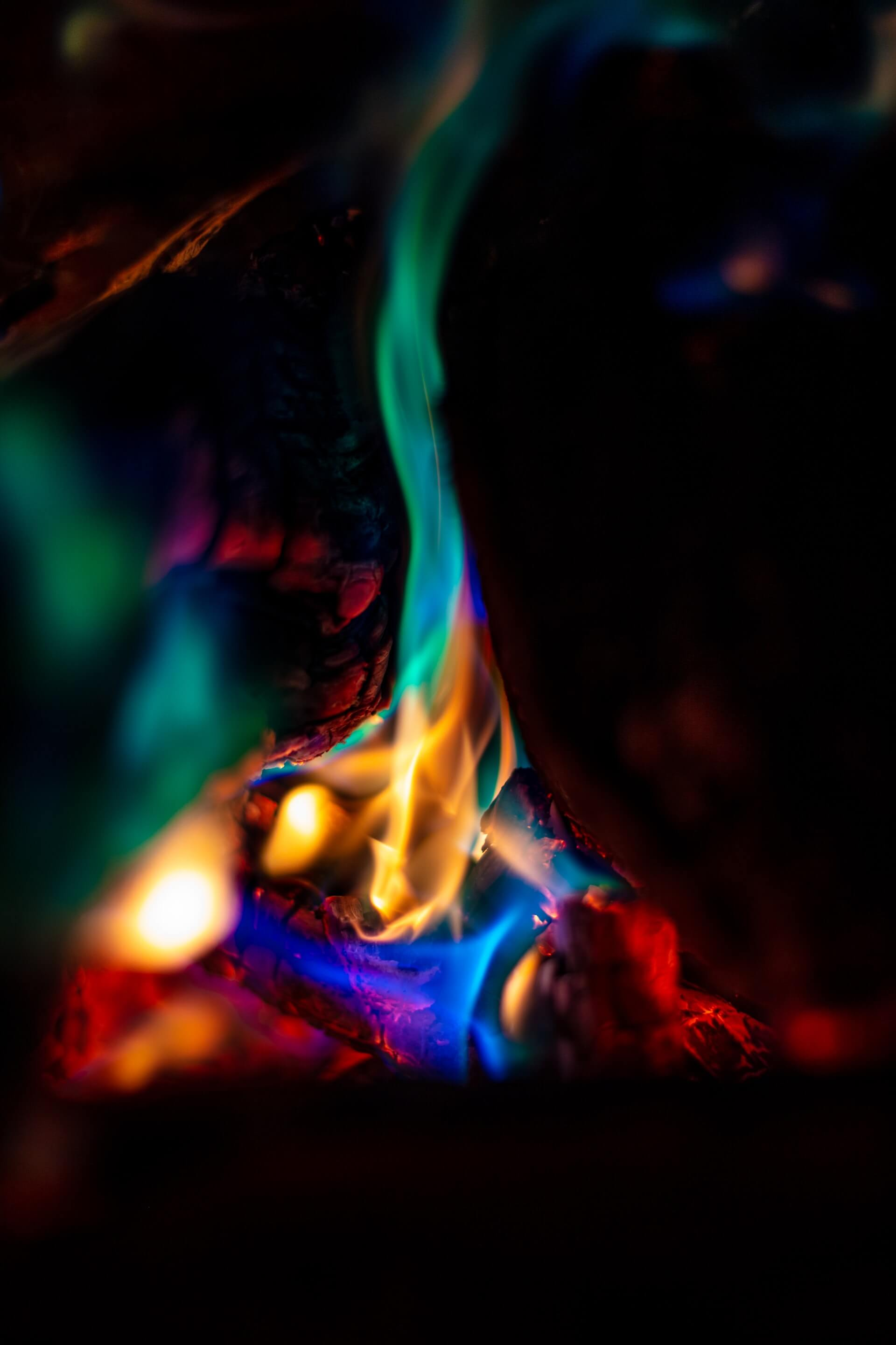 bonfire at night fire different colors green yellow blue