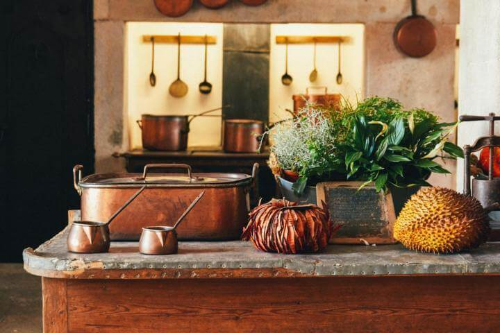 copper cooking items placed on a brown island kitchen counter