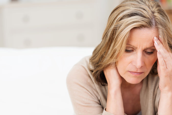 What causes menopausal dryness?