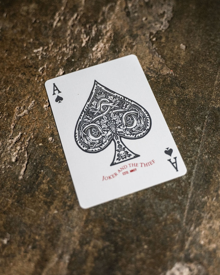 The ace of spades featuring gray ink with red and silver metallic ink accents