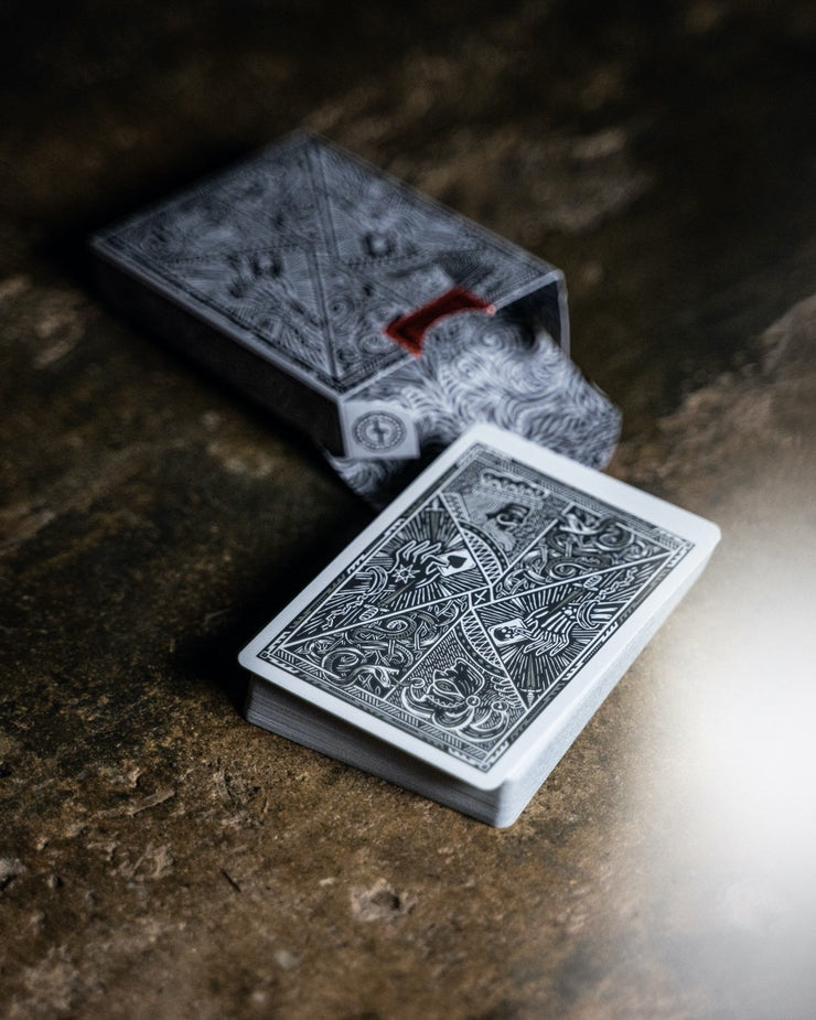 The cards of Street Edition revealing the back design protruding from the tuck box on a concrete surface