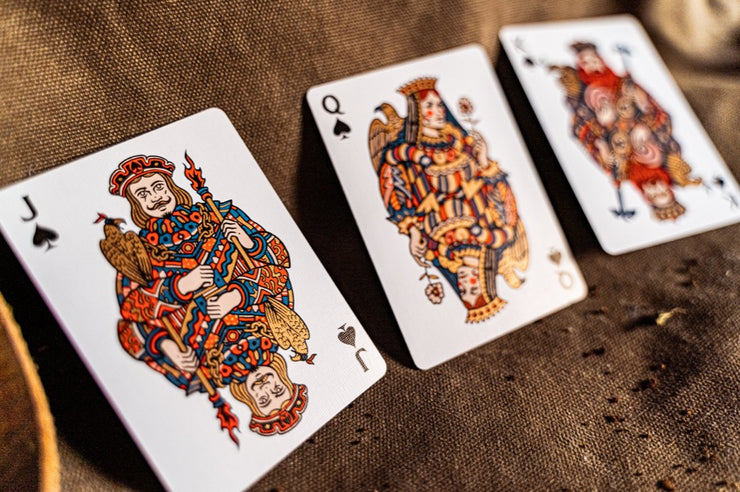 The jack, queen, and king of spades. Each of these court cards represent the sky and eagles and falcons accompany each card. Each card features red and blue ink as well as bronze metallic ink.