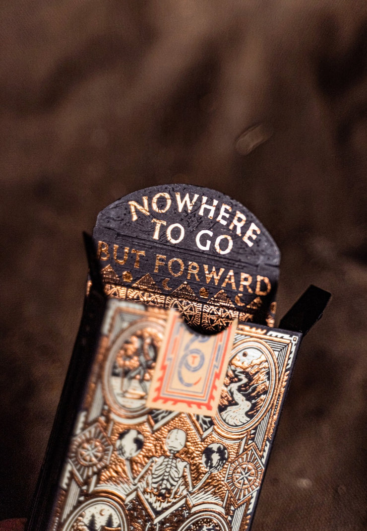 "The interior of the wayfarers tuck box is displayed. At the flaps of the interior states ""Nowhere to go but forward."" It is accompanied by a tessellated interior pattern printed in foil."