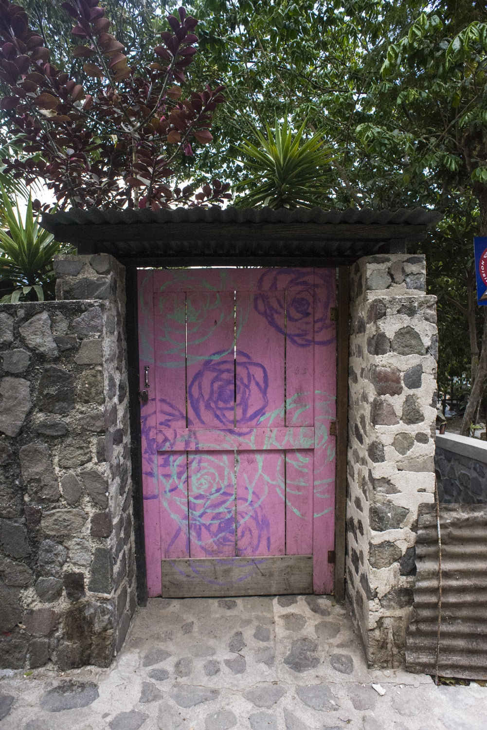 pink painted doorway in san marcos la laguna