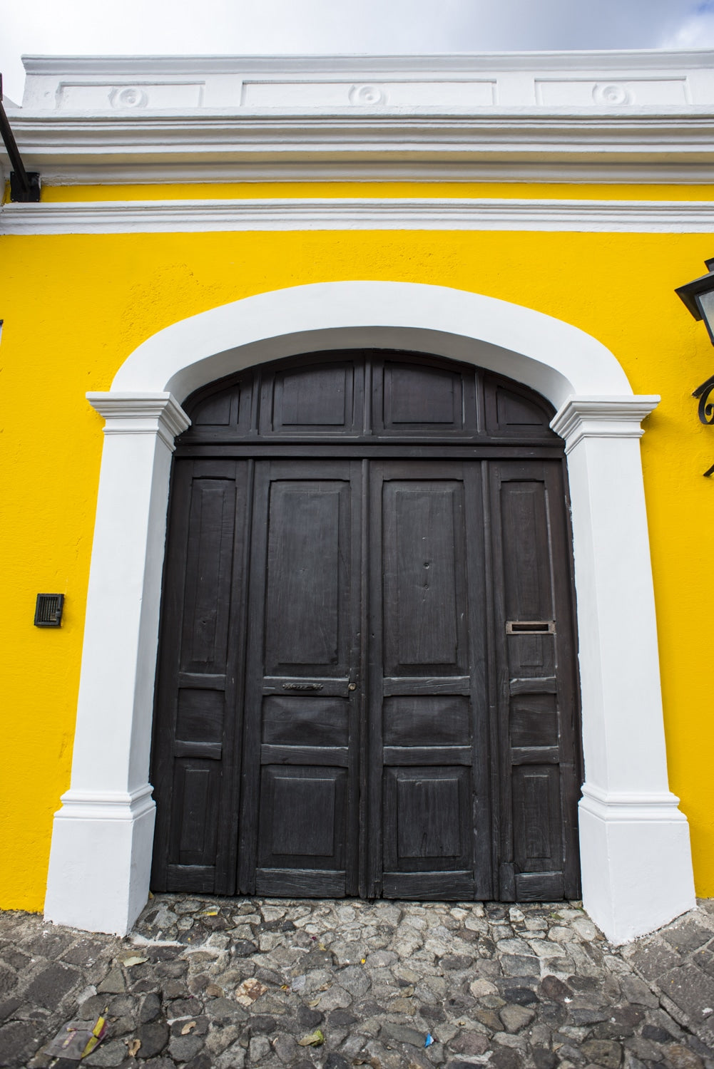 yellow arched doorway antigua guatemala